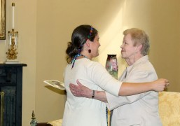 Emily gets a hug of congratulations from Sister Nancy Nolan, a member of the Sisters of Providence new membership team.