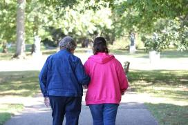 Leaning on each other: Sister Kay Kelly and Candidate Patti Burris during a walk.
