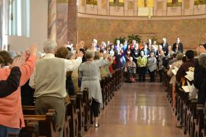 Those gathered in the Church bless the newly committed Providence Associates.