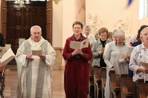 Father Dan Hopcus and General Superior Sister Dawn Tomaszewski process in at the beginning of the Liturgy.