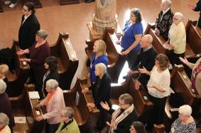 Providence Associates first committing and those renewing their commitments join in prayer with sisters and friends.