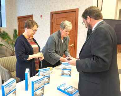 Providence Associate Jane Fischer (left) and Providence Associate Assistant Director Debbie Dillow help a man purchase his own copy of Mother Theodore's Journals and Letters after the play. Photo: Providence Associate Marilyn Rausch.