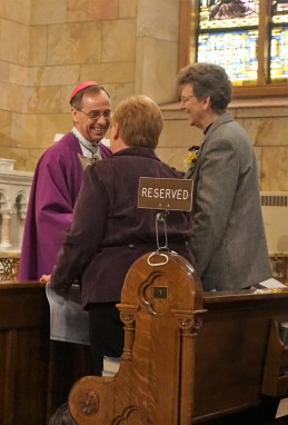 Most Reverend Bishop Charles C. Thompson, D.D., JCL, of Evansville, talks before the mass with General Officer Sister Mary Beth Klingel (Jasper native), and General Superior Sister Dawn Tomaszewski (right). Photo: PA Marilyn Rausch.