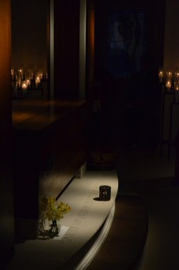 The chapel room of the Shrine of Saint Mother Theodore Guerin lit by candlelight for the vigil with Saint Mother Theodore Guerin during the Providence Associate retreat.