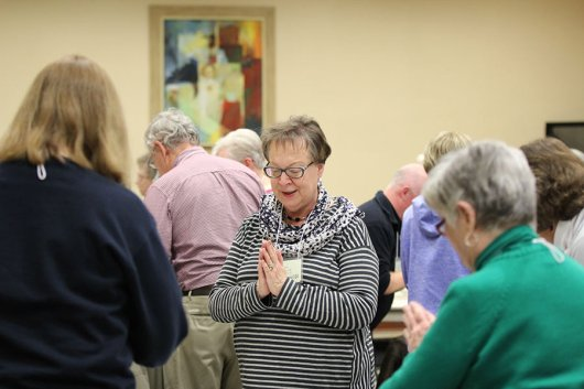 Providence Associate Jane Fischer bows to God present in others gathered at the retreat.