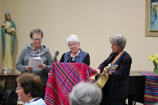 Providence Associates Jane Fischer and Diann Neu and Sister Jeanne Hagelskamp lead a song during the retreat.