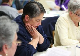 Sister Joni Luna prays with the gathered Providence Associates on Friday night at the retreat.