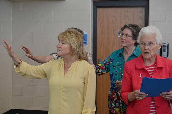 Saint Mary-of-the-Woods College President Dr. Dottie King (front, left) during the blessing for the sculpture of Sister Jeanne Knoerle, which was provided by Sister Jean Fuqua (front, right).