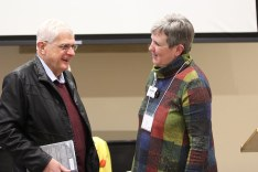 Chuck Neuman visits with Providence Associate Co-Director Debbie Dillow before the retreat.