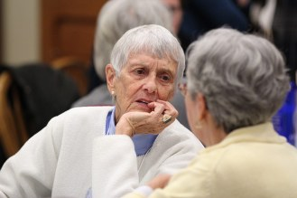 Sister Mary Morley listens to an associate.