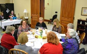 Providence Associate Teresa Clark shares at her table as Sister Sue Paweski, Mel Marino Wolff and others look on.