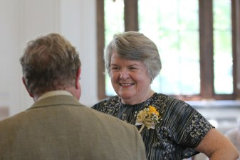 Sister Jody O'Neil greets a guest at the reception