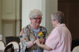 Sister Jan Craven is greeted by Sister Donna Butler.
