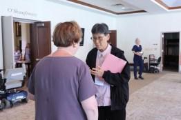 Sister Delan Ma listens to Providence Associate Jane Fischer.