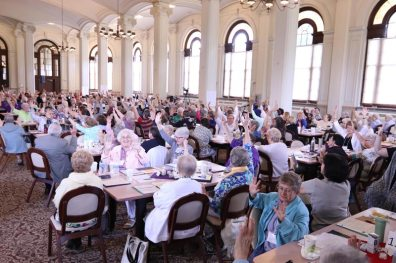 How many people can you invite to lower their carbon usage? Sisters of Providence and Providence Associates show on their hands.