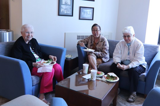 Smiling during lunch, are from left, Sisters Carolyn Kessler, Doreen Lai and Mary Jo Piccione.