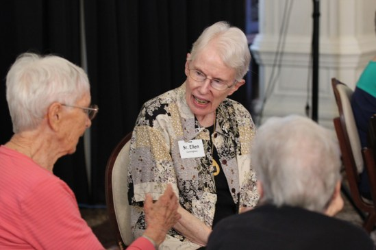 Sister Ellen Cunningham in discussion with other sisters.