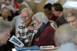 Providence Associate Paul Salstrom and Sister Nancy Bartasavich share a prayer booklet.