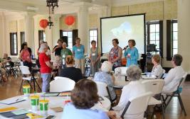 Providence Associate participate in deciding if they deem a situation violent or nonviolent during Friday's workshop led by Sister Kathleen Desautels. Maureen Baca speaks at the microphone at right.