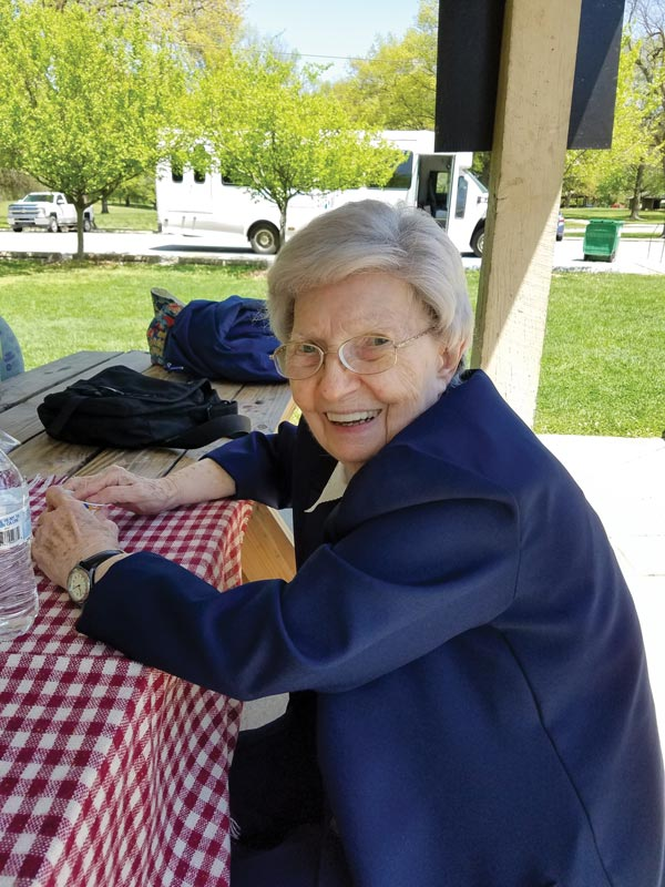 Sister Laurine Haley relaxes at a picnic table at Deming Park.
