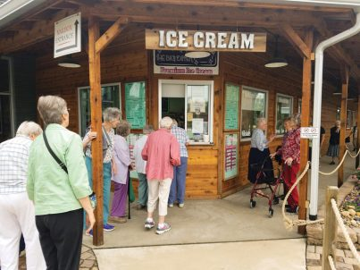 Sisters line up to get ice cream on their visit to Casey, Illinois.