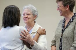 Sister Barbara Doherty welcomes the new postulant.