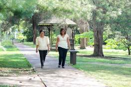 Vocation Director Sister Editha Ben, who has accompanied Jessica on her discernment journey over the past several years, accompanies Jessica on her walk to Providence Hall for her official entrance into the Congregation.