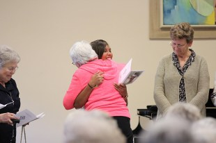 Jessica receives a hug from Sister Nancy Bartasavich after receiving a blessing from her.