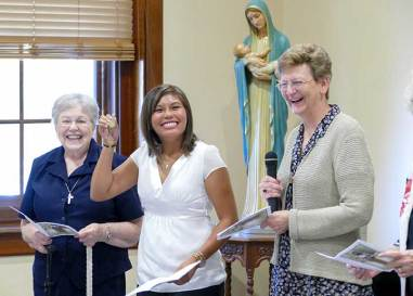 During her entrance ceremony to the Sisters of Providence of Saint Mary-of-the-Woods, Indiana on Sept. 10, Jessica Vitente, center, was welcomed with keys to her new home. At left is Sister Jeanette Lucinio and at right is Sisters of Providence General Superior Sister Dawn Tomaszewski.