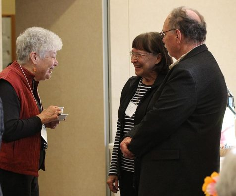 Sister Rosemary Nudd visits with Providence Associate Beverly Okey and her husband William, a Providence Associate candidate.