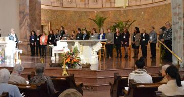The new Providence Associates gather at the altar for a blessing
