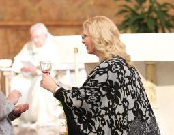 New Providence Associate Adrienne Bates-Brown distributes communion
