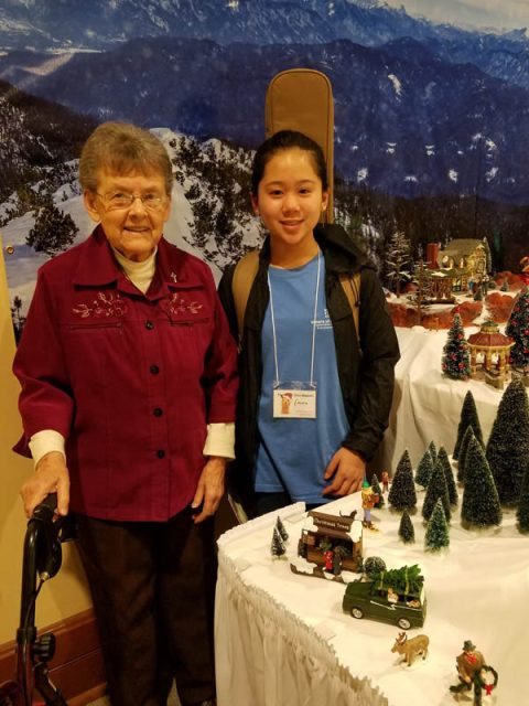 A Providence Teen Ministry volunteer assists Sister Patricia McIntyre as she attends activities.