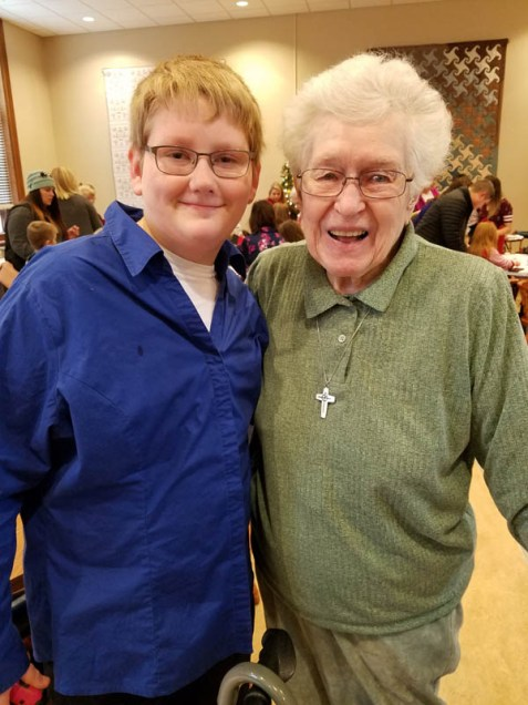 A Providence Teen Ministry volunteer accompanies Sister Joyce Brophy to several of the Christmas Fun activities.