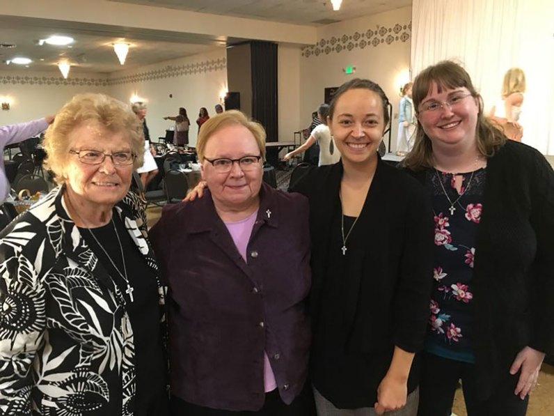 Sister Tracey Horan, second from right, poses with, from left, Sisters James Michael Kesterson, Mary Beth Klingel and Arrianne Whittaker at the award ceremony.