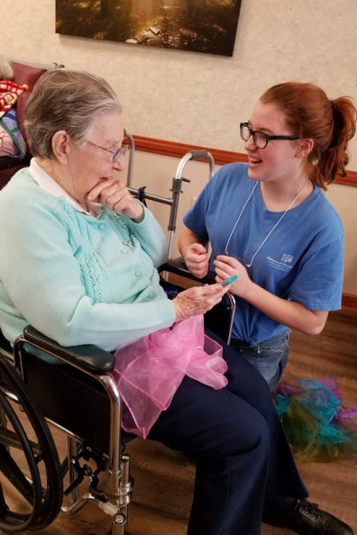 Sister Laurine Haley visits with a teen volunteer