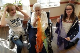 Volunteers playing around with a resident of Providence Health Care