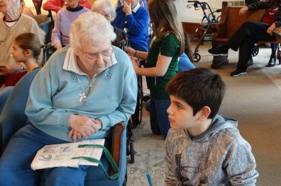 Sister Dorothy Ann Wolsiffer visits with a teen