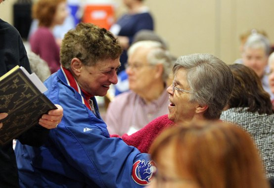 Phyllis Harman greets Sister Betty Koressel.