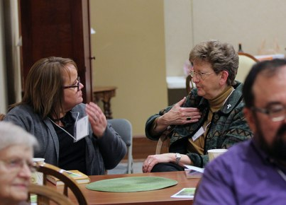 Providence Associate Christine O'Connor and Sister Dawn Tomaszewski discuss a point.