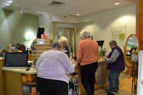 Sisters and associates shop at Linden Leaf Gifts during break time. Sister Cynthia Lynge rings up their sales.