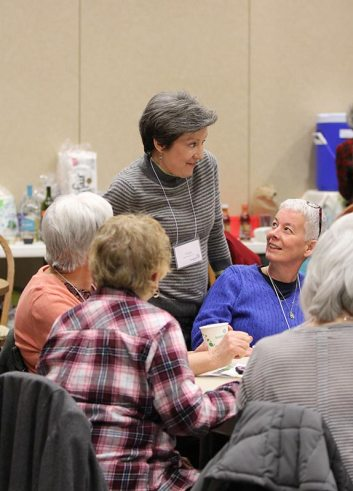 Providence Associates Peggy Bowler and Sheila Galvin chat during down time.
