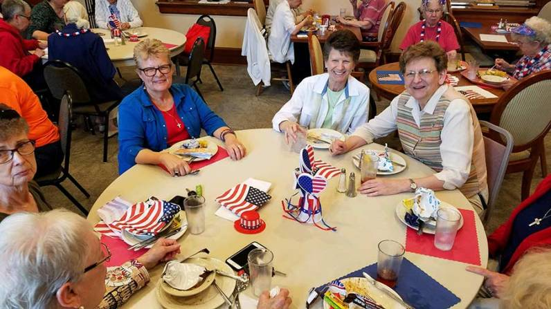From left, Sisters Susan Paweski, Pam Pauloski and Dawn Tomaszewski enjoy the 4th of July luncheon.