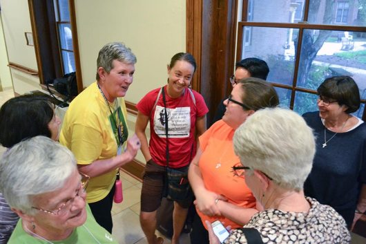Providence Associate Co-Director Debbie Dillow, left, jokes around with Sisters Tracey Horan, Emily TeKolste and others during a social time.