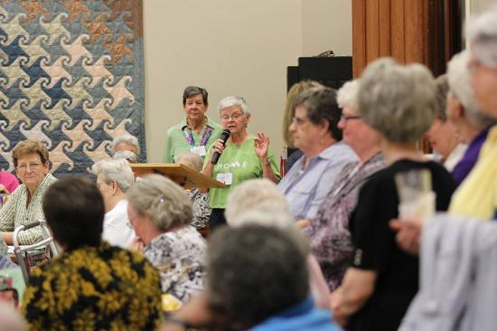 Sister Denise Wilkinson introduces the HOME team activities Sunday evening.