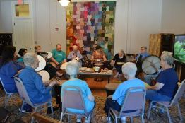 Providence Associates volunteered at the drumming circle on Friday morning