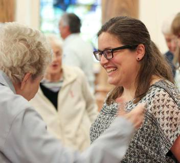 Sister Emily is greeted by a sister after Mass.