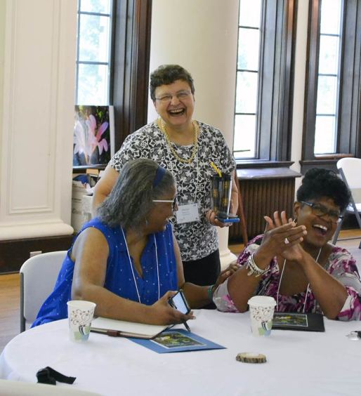 From left, Providence Associates Pearlette Springer, Marilyn Rausch and Lynda Parker share a big laugh.