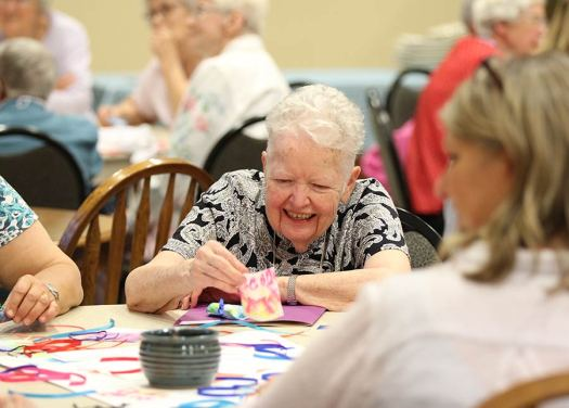 Sister Grace Marie Meehan participates in an art therapy demonstration.