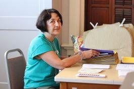 Providence Associate Monica Hayden volunteers stuffing folders Friday morning.